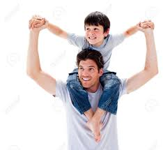 Close-up Of Father Giving His Son Piggyback Ride Stock Photo ...